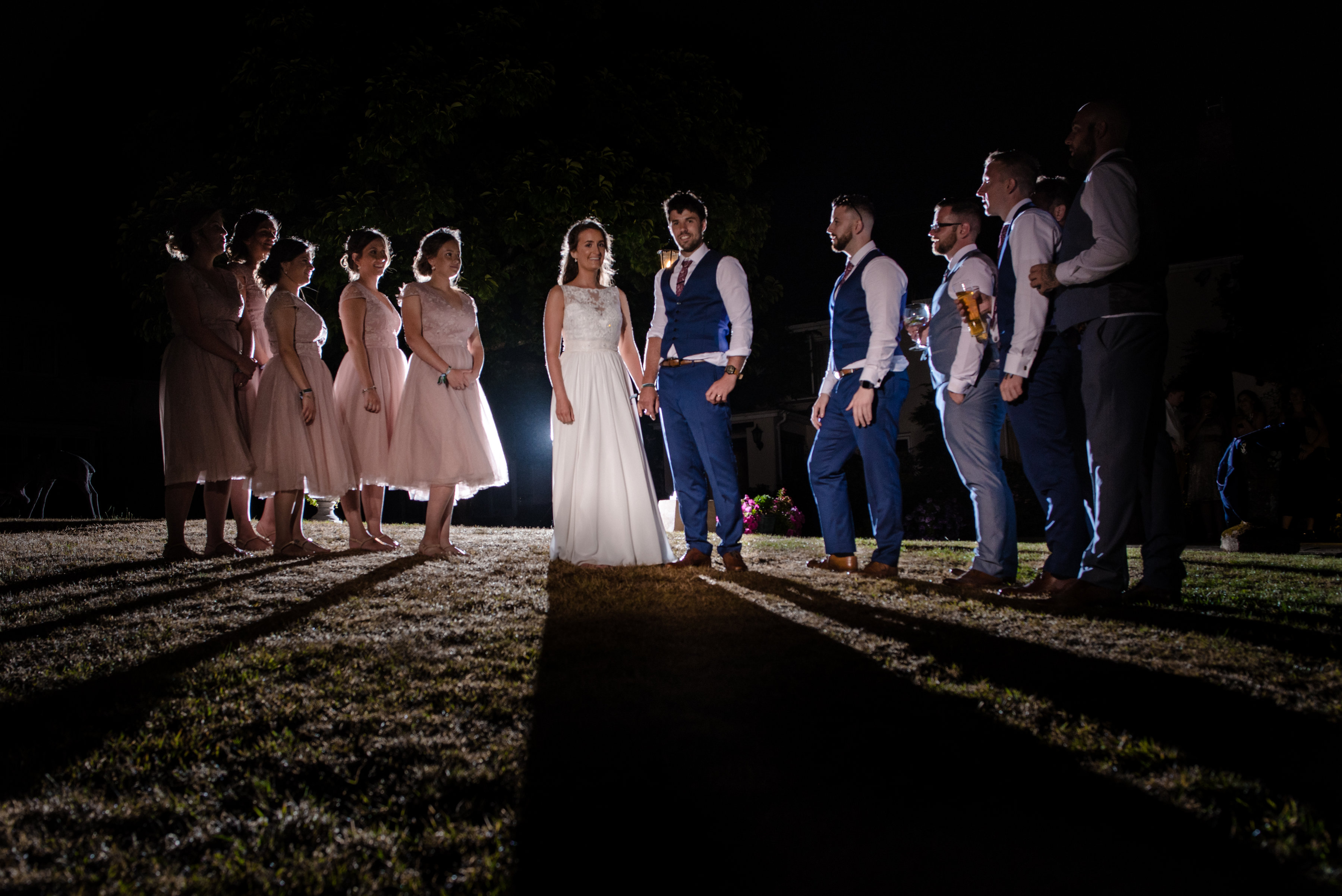 Couple with their bridesmaids and groomsmen night group photo