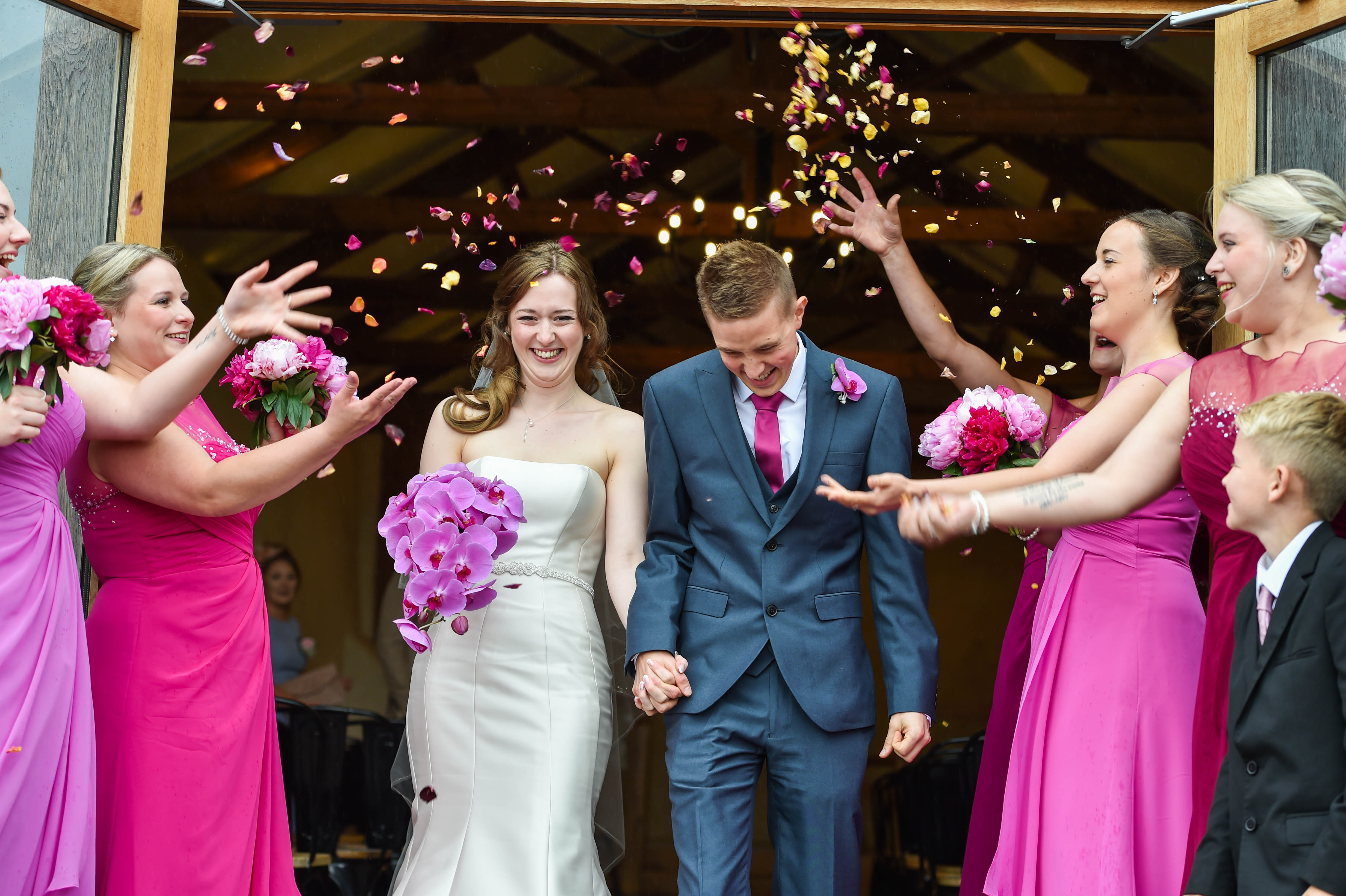 Bride and groom showered in confetti at Upton Barn & Walled Garden