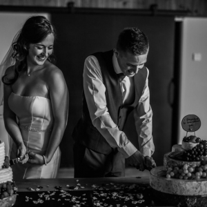 Bride and groom cut their individual wedding cakes