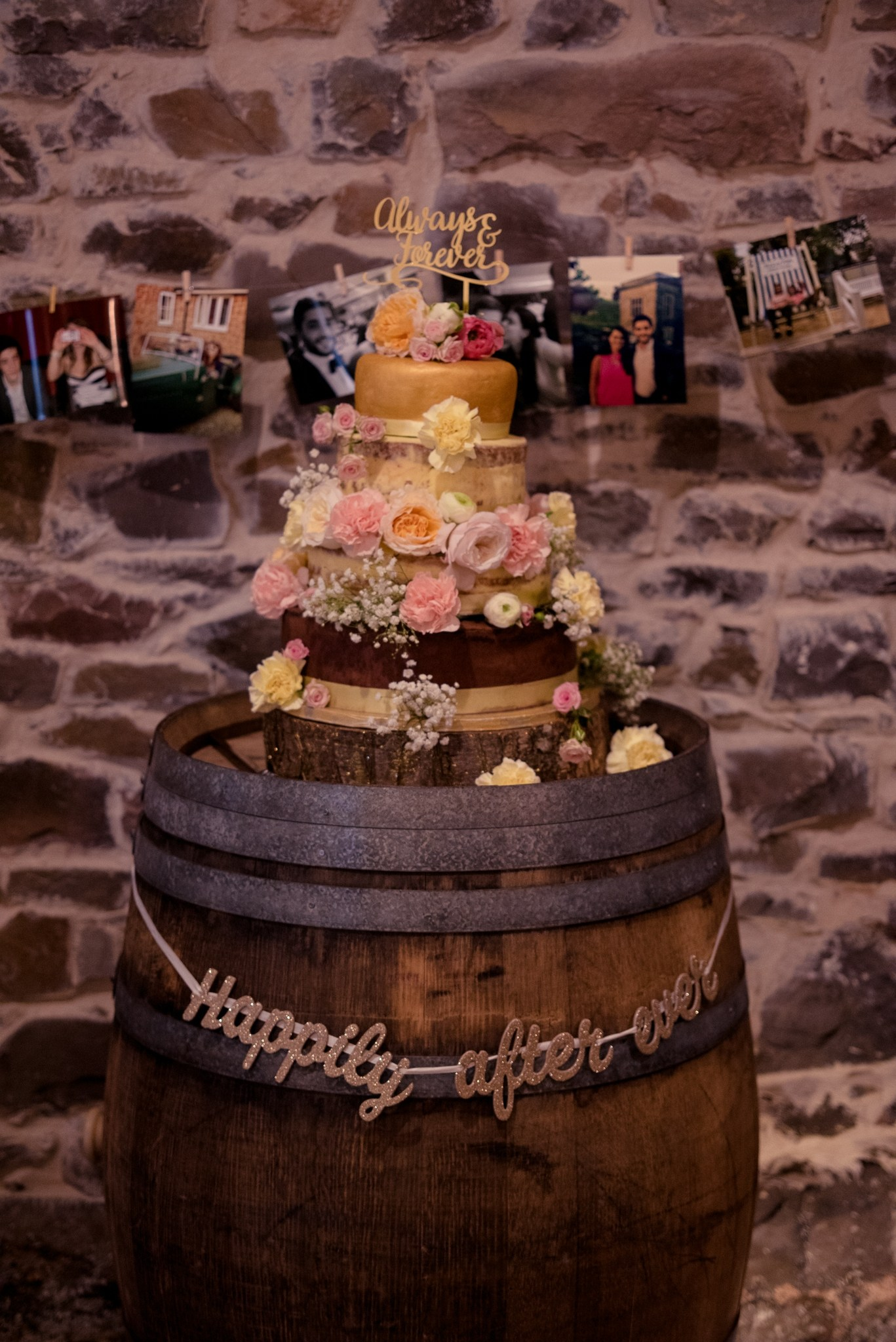 Wedding cake above an oak barral in the Cider Barn