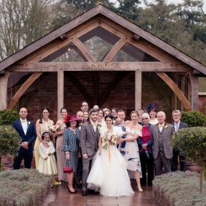 Bridal party group by the arbour