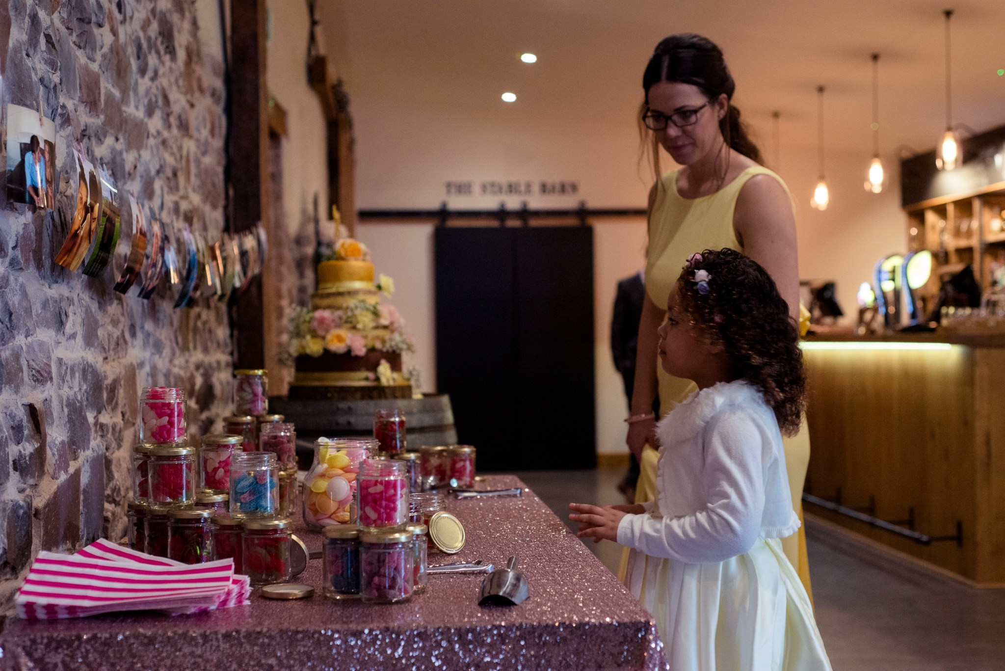 Flower girl eyes the sweetie bar in the Press