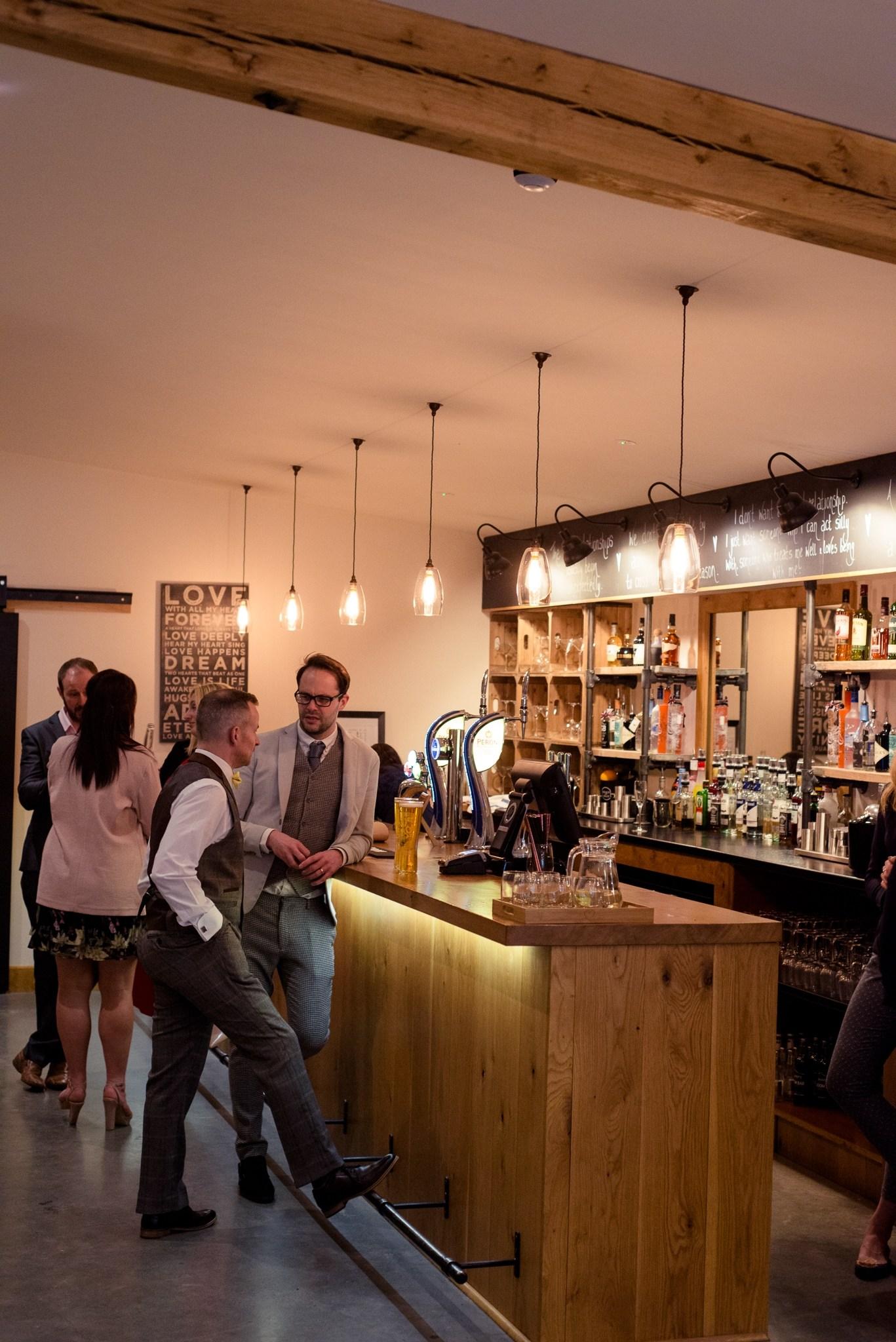 Guests enjoying a drink at the Press Bar