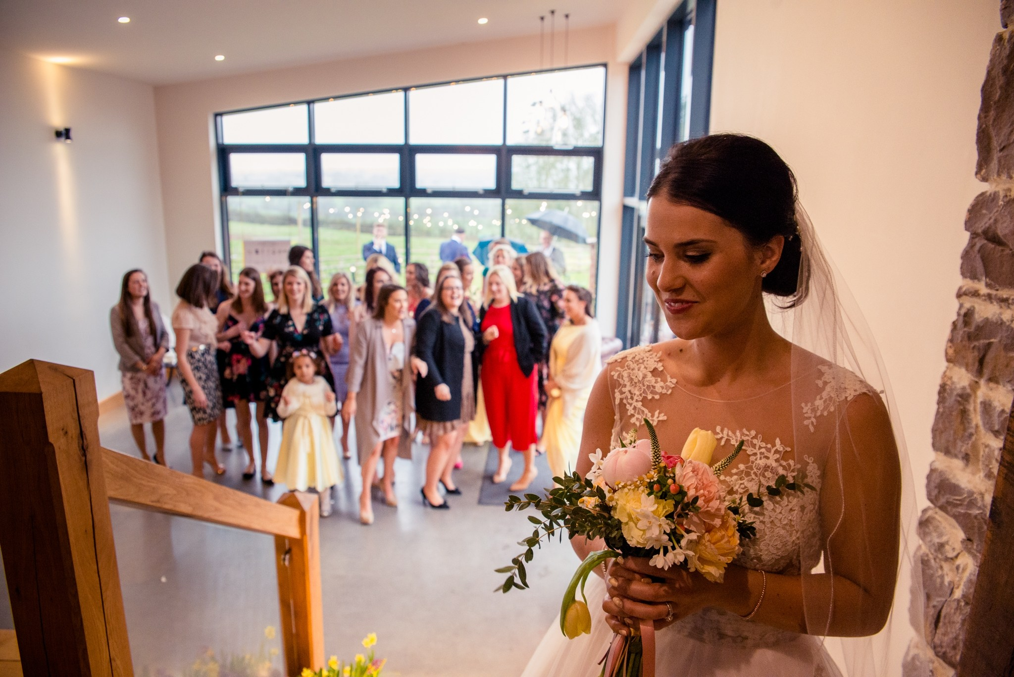Bride prepares to throw her bouquet to gathering guests