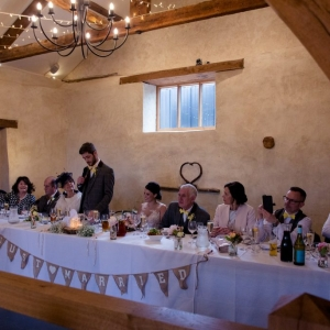 Groom gives his speech from the top table