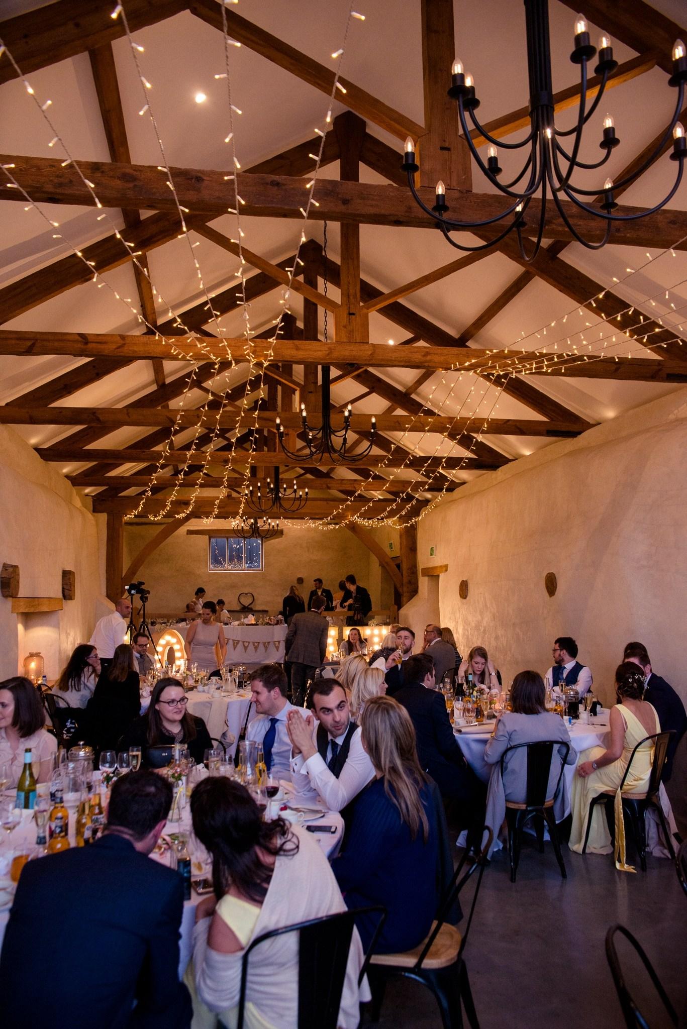Wedding gusest enjoying dinner in the Cider Barn