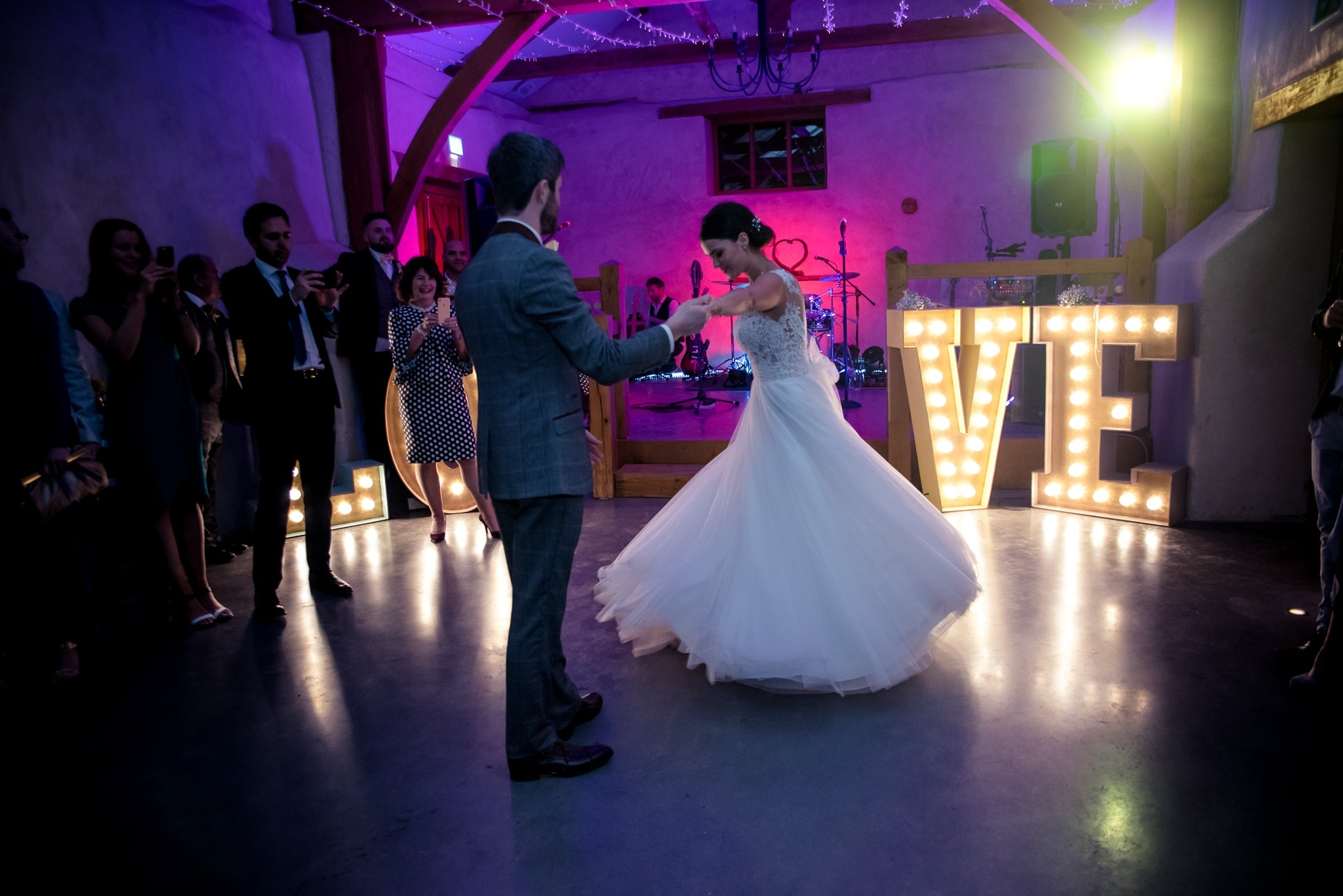 Bride and her groom sweep accross the dancefloor of the Cider Barn at Upton Barn & Walled Garden