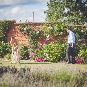 Two wedding guests play croquet in the Walled Garden at Upton Barn & Walled Garden