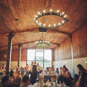 Guests enjoying the wedding breakfast served in the Stable Barn at Upton Barn & Walled Garden