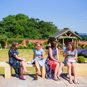 Wedding guests enjoy drinks in the garden at Upton Barn & Walled Garden