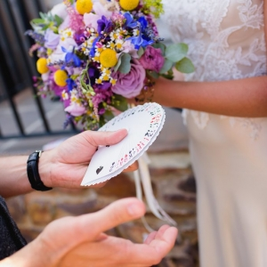 Magician close up performs card trick for the bride