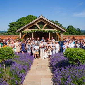 Wedding party pose for group photo in the walled garden