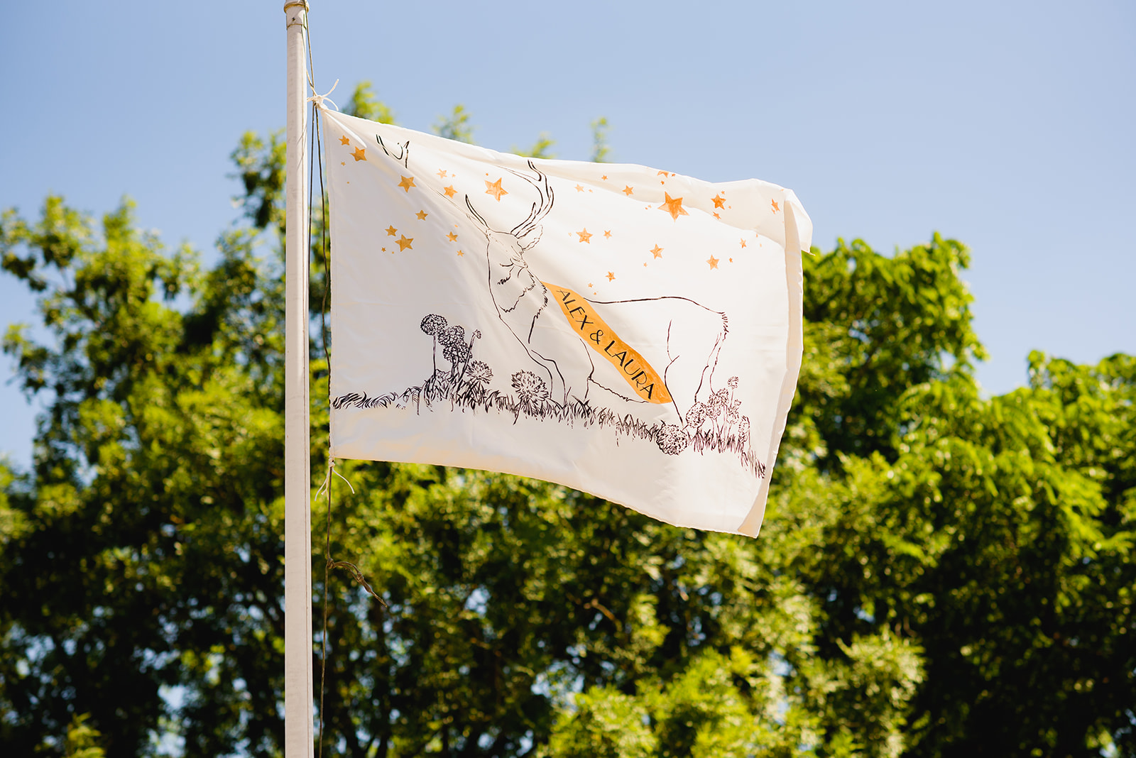 Custom flag raised for the bride and groom at Upton Barn & Walled Garden