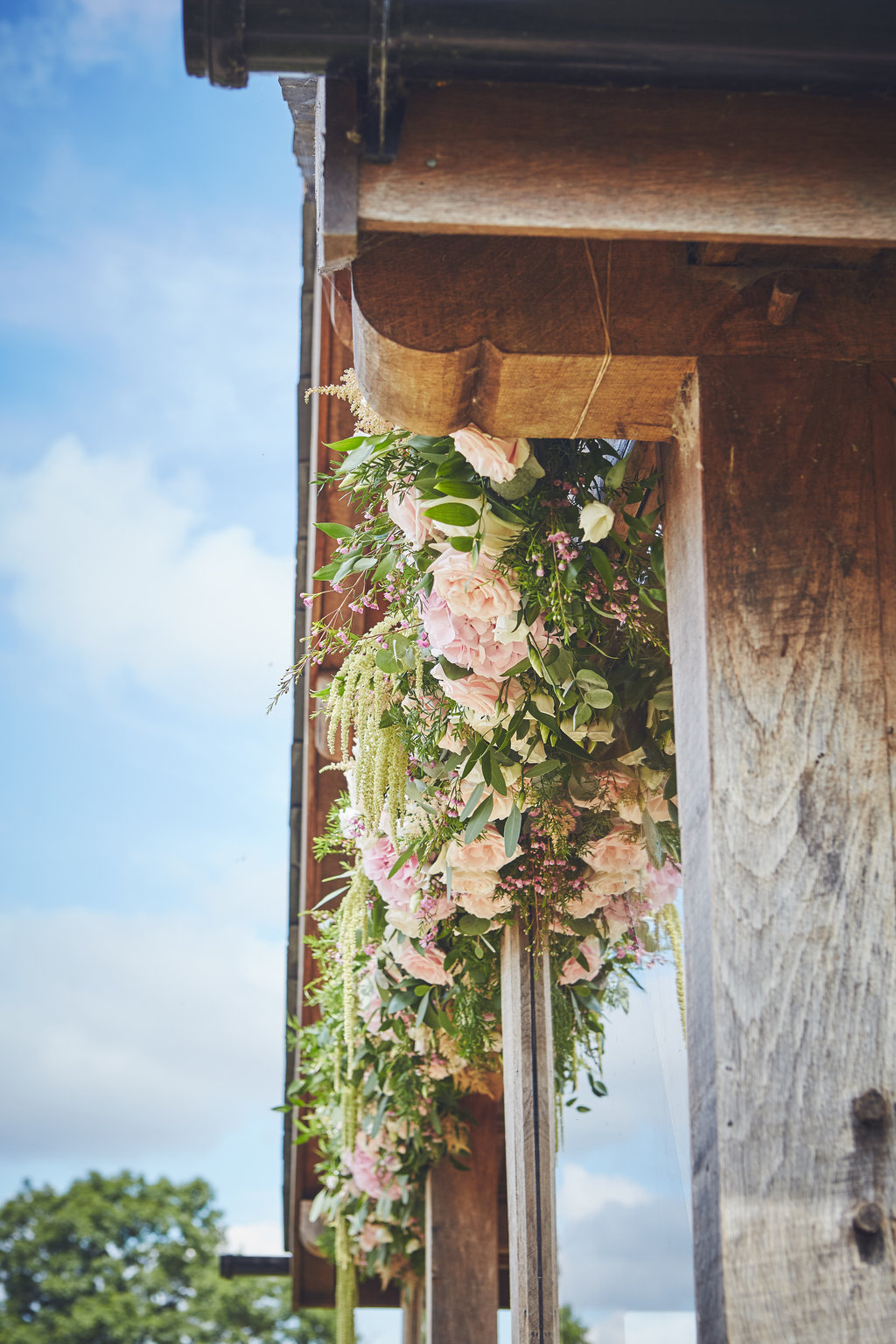 Floral garland adorns the arbour