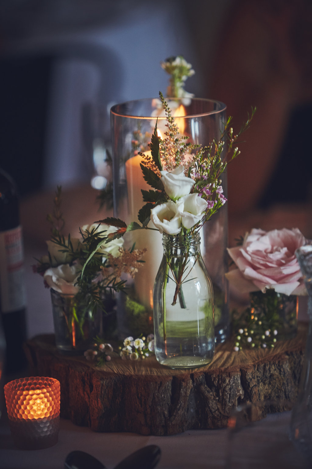 Close up of flowers and candle table center pieces