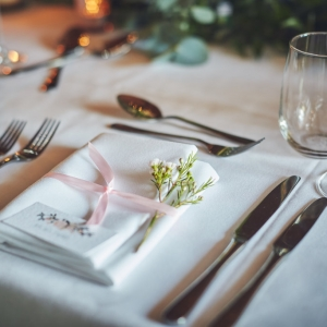 Place setting with fresh flowers close up