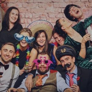 Bridal party pose for fun photobook at Upton Barn