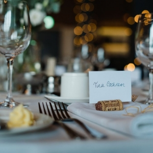 Wedding breakfast setting with bokoh lighting at Upton Barn