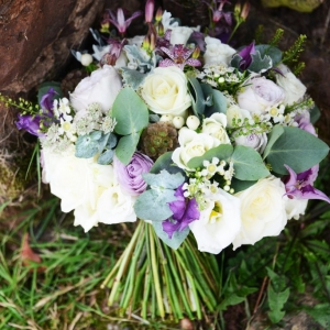 Close up of green, ivory and purple bridal bouquet