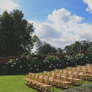 Seating for civil ceremony set up in the Walled garden at Upton Barn