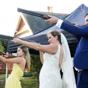 Bride and Groom enjoy shooting on their wedding day at Upton Barn