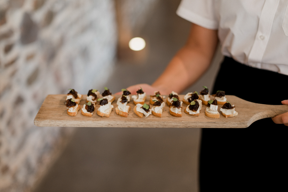 Close up of canapes served on a wooden board at Upton Barn