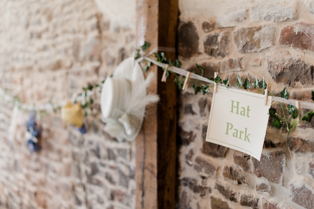 Hat Park by stone wall of the Cider Barn at Upton Barn and Walled Garden