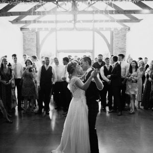 Bride and Groom take their first dance on the floor of the Cider Barn at Upton Barn
