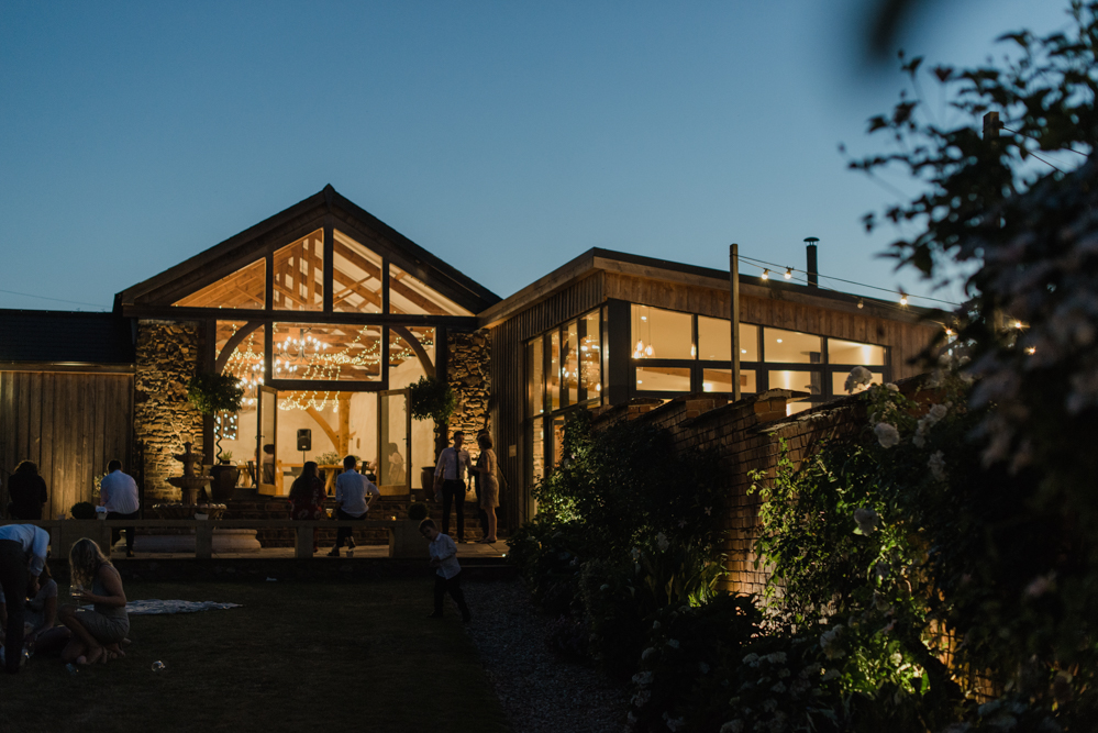 The Cider Barn at night at Upton Barn and Walled Garden