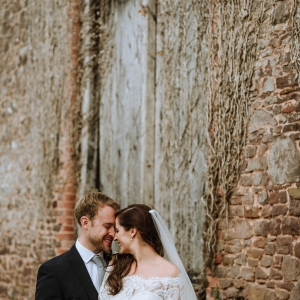 Bride and Groom head to head by the old barn at Upton Barn