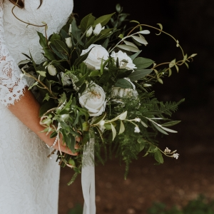 Close up of brides bouquet of white and green
