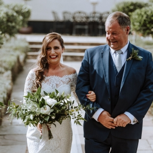 Bride walks down the aisle at Upton Barn with her father when she spots the groom