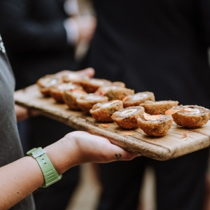 Close up of canapes served to guests on a wooden platter at Upton Barn