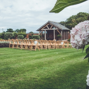 The Arbor and Walled Garden at Upton Barn set up with chairs for a wedding ceremony