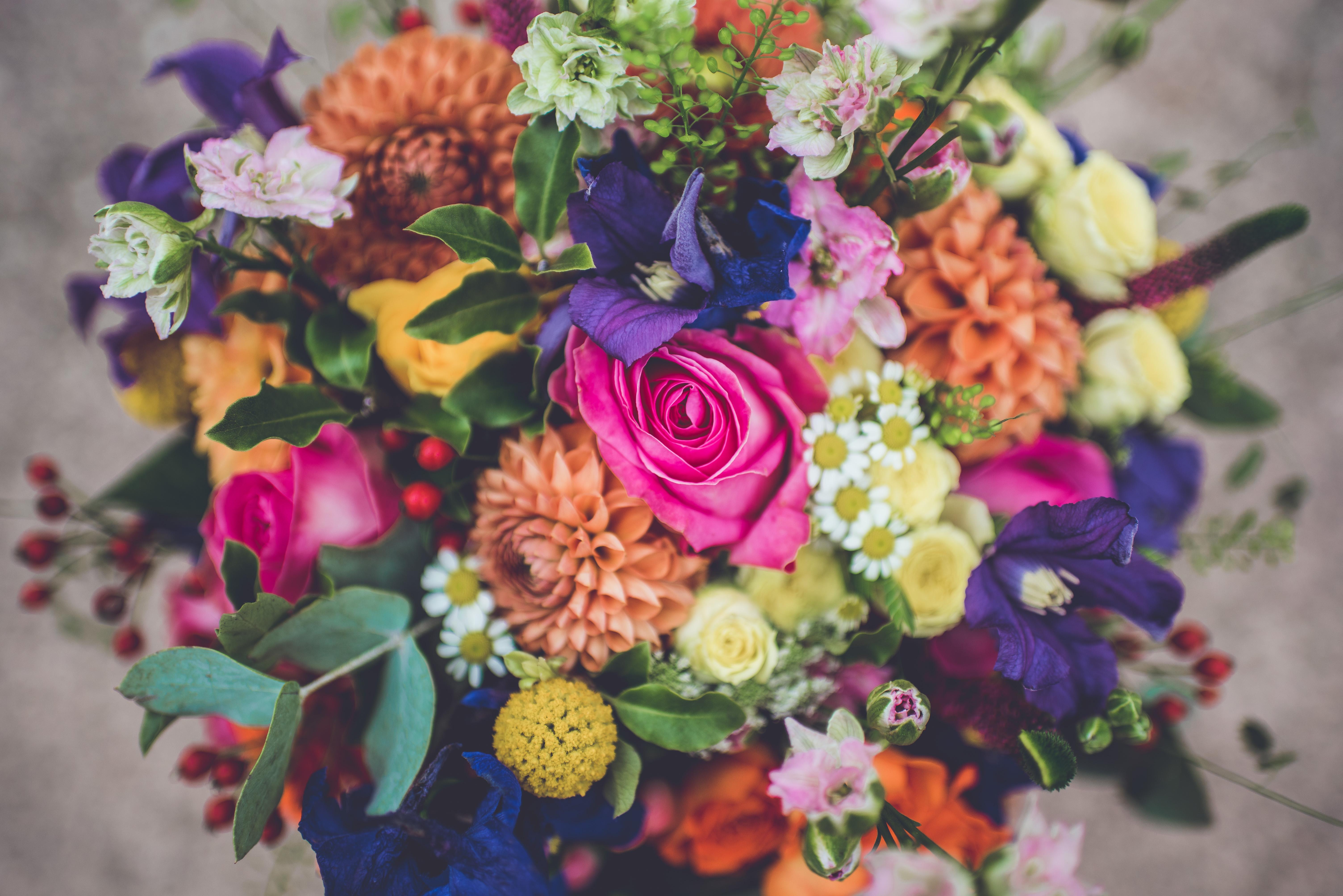 Close up of colour filled floral brides bouquet