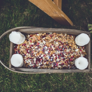 Basket filled with dried flower petal confetti with paper cones