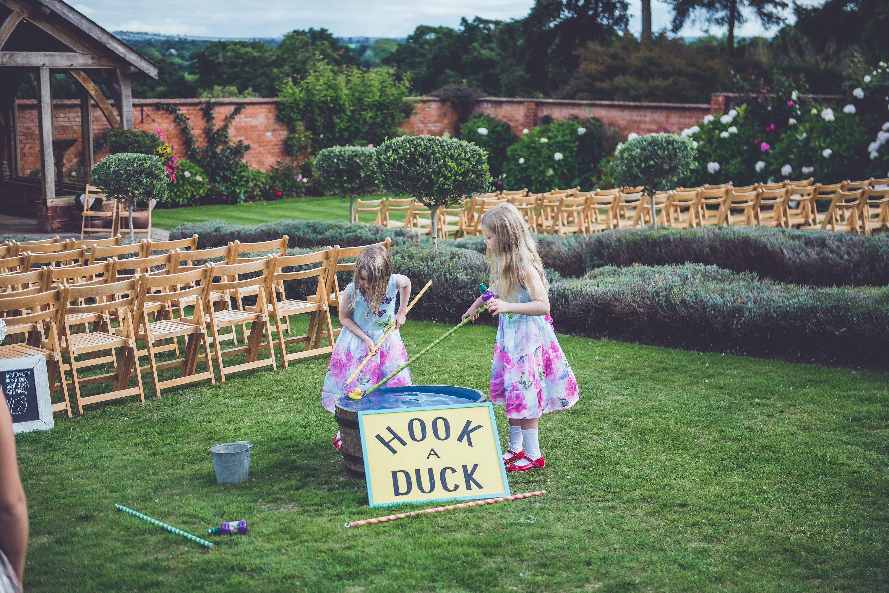 Flowers girls play Hook-A-Duck in the Walled Garden at Upton Barn