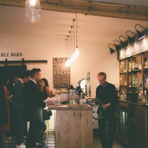 Guests being served at the Press Bar at Upton Barn
