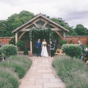 Bride and Groom receive their marriage certificate in the Arbor at Upton Barn