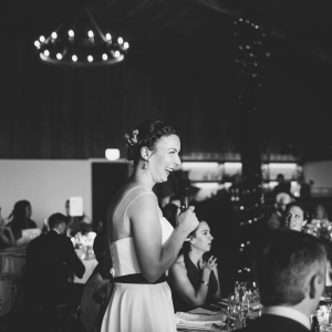 Bride takes the microphone and entertains her guest in the Stable Barn at Upton Barn