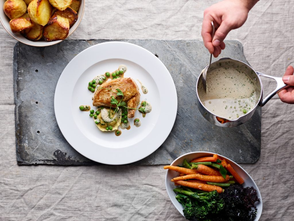 Butter roast chicken, pea and mint tortellini, fresh peas and a truffled chicken veloute