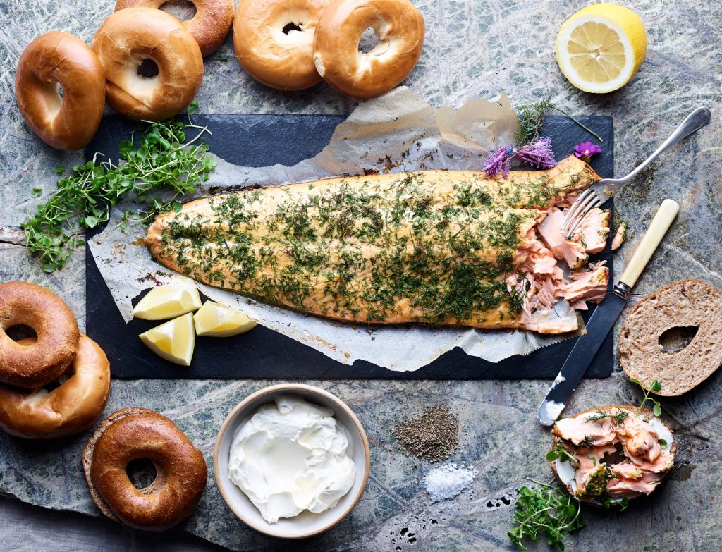 Whole side of dill roast salmon, fresh baked bagels, and cream cheese