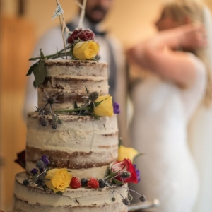 Naked wedding cake with bunting topper