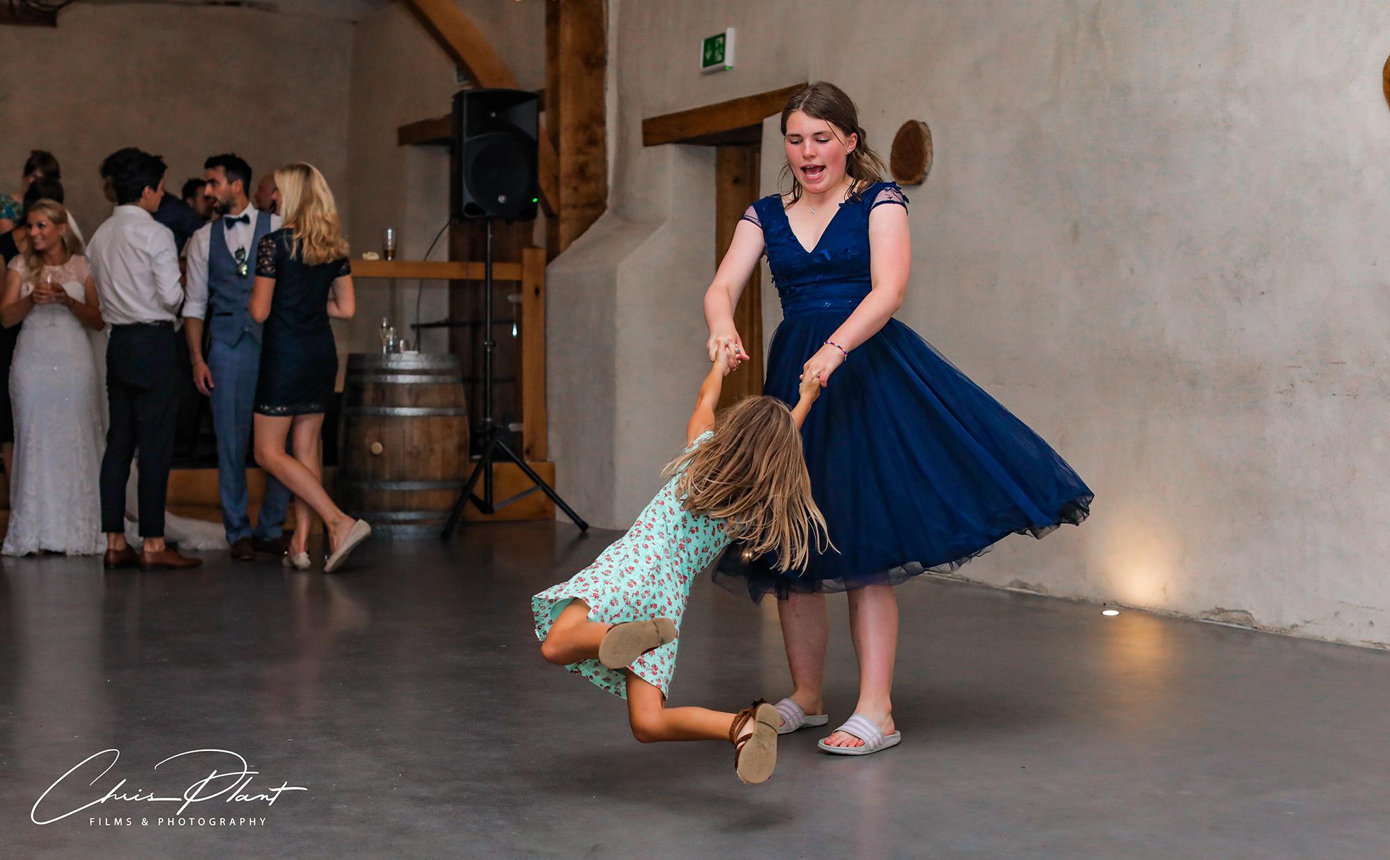 Young girls swing round dancing on the dancefloor