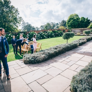Arrival of the bride in walled garden