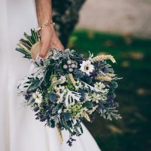 Close up of brides thistle bouquet