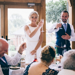 Bride and Groom raise glasses to toast