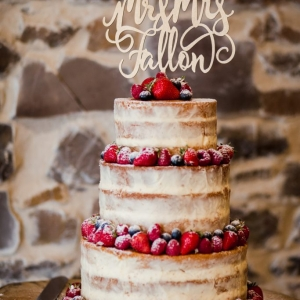 Naked wedding cake with name topper