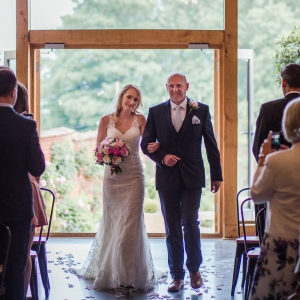 Bride walked down the aisle by her father
