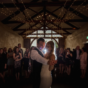 Bride and groom take their first dance in the Cider Barn